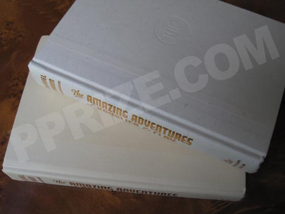The first edition has colored threads on white paper with a white cloth spine.  Later