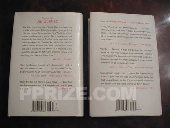 The book on the left is the first issue dust jacket.  The book on the right is the second