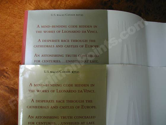 The first edition Da Vinci Code dust jacket has a golden tone on the flaps that is most