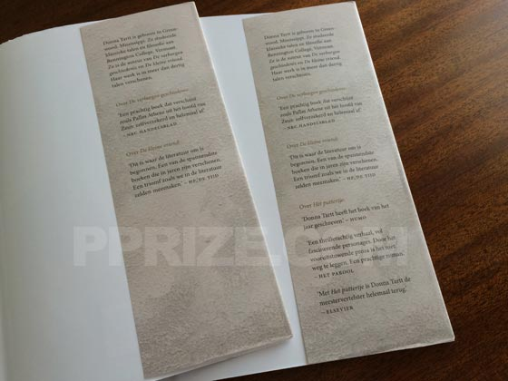 On the left is the back dust jacket flap from a first edition. Note that it only has two