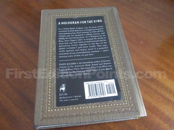 There is a removable sticker on the back of the first edition of A Hologram For The King.