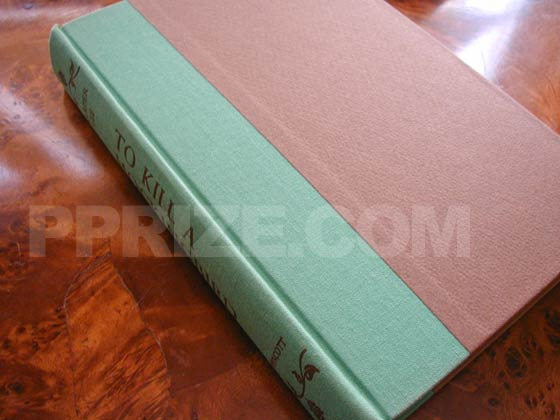 Boards are brown with green cloth spine cover.