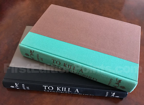 The first edition binding of To Kill a Mockingbird on the top with its green spine is