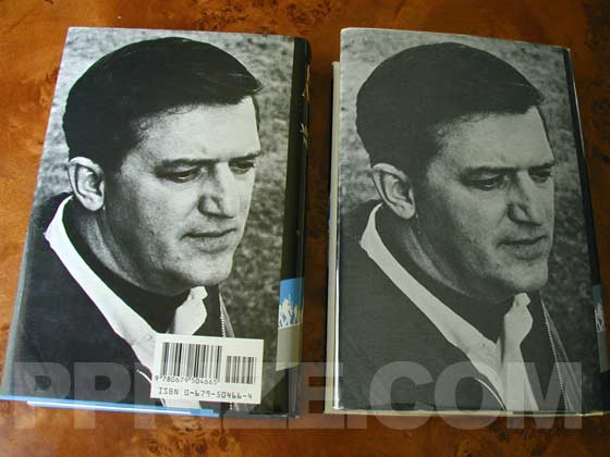 The reprint edition (on the left) has a bar code on the back of the dust jacket.  The