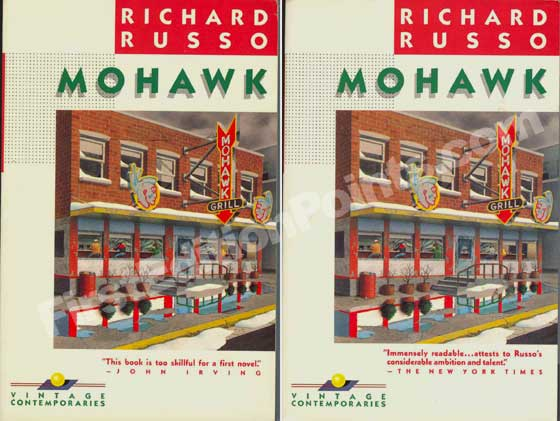This picture is a comparison of the two front cover variations of Mohawk.  On the left is