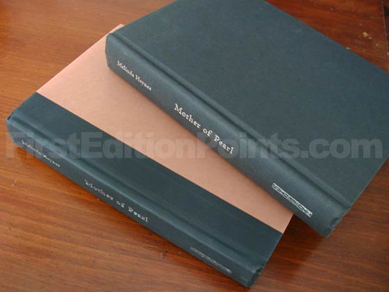 The first edition has terra cotta boards with a black cloth spine.  Later Oprah printings