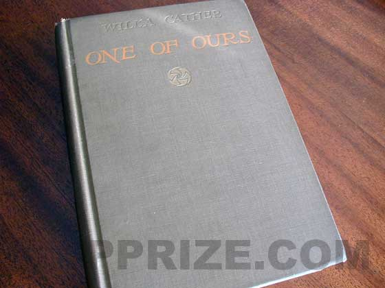The first trade edition of On of Ours had brown cloth boards with orange titles and gilt