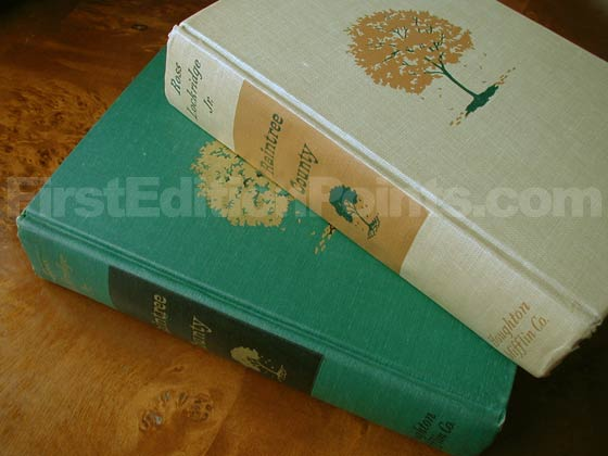 This photo shows the two binding variants.  The first printings have always been seen in