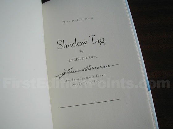 This is the publisher's tipped-in signature page from the specially bound signed