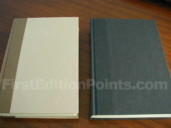 The first U.S. edition on the left has cream boards with a brown cloth spine.  The U.S.