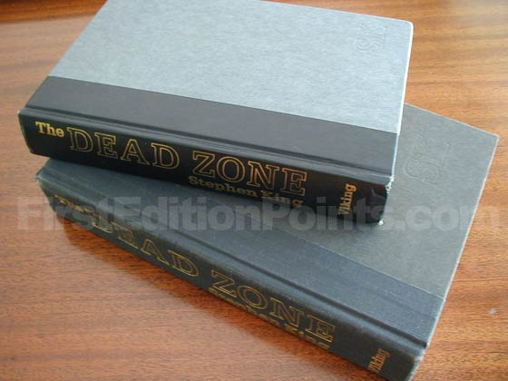 The book club edition has light blue boards with a black paper spine instead of the black