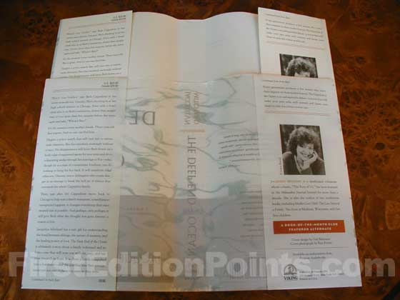 The dust jacket on the top is the first issue made of translucent glassine to allow the