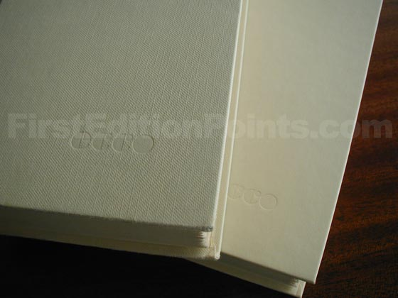 The true first edition has textured cream boards like the one on the left.  The book