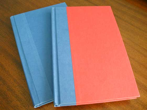 First printings have blue boards.  Later printings are red and blue.