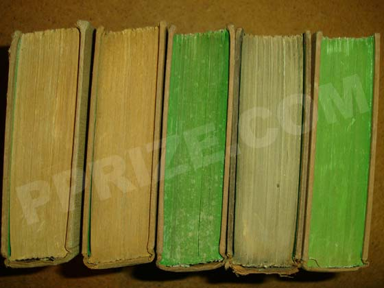 Photo of brown and green top stains on early printings.  Left to right are 1) First