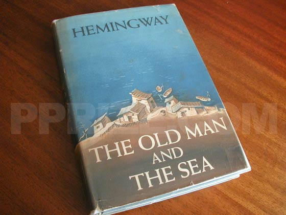 Picture of the 1952 first edition dust jacket for The Old Man and the Sea.